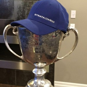 The Grey Cup wearing Strata Controls hat